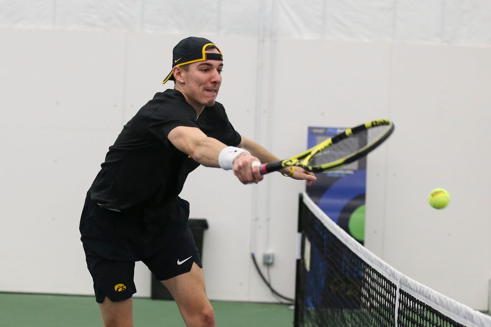 during the Iowa men's tennis meet vs VCU  on Saturday, February 29, 2020 at the Hawkeye Tennis and Recreation Complex. (Lily Smith/hawkeyesports.com)