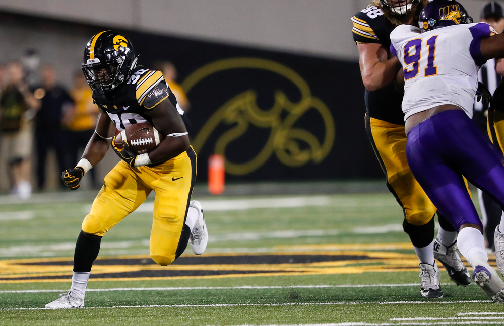 Iowa Hawkeyes running back Henry Geil (30) runs the ball during a game against Northern Iowa at Kinnick Stadium on September 15, 2018. (Tork Mason/hawkeyesports.com)