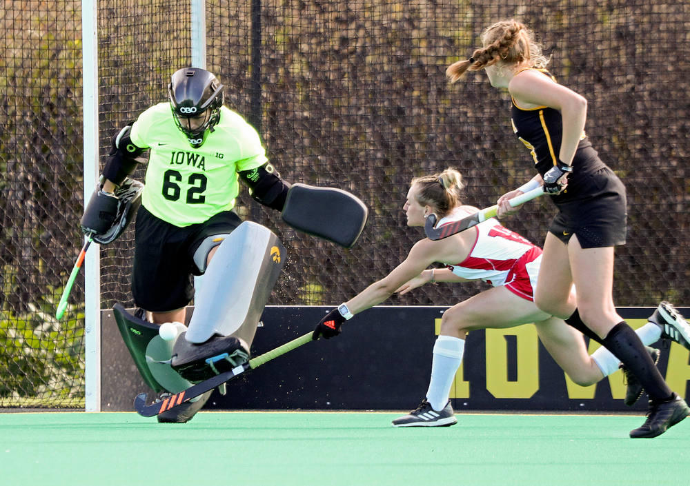 Iowa's Grace McGuire (62) kicks a shot away for a save during the fourth quarter of their match at Grant Field in Iowa City on Friday, Oct 4, 2019. (Stephen Mally/hawkeyesports.com)