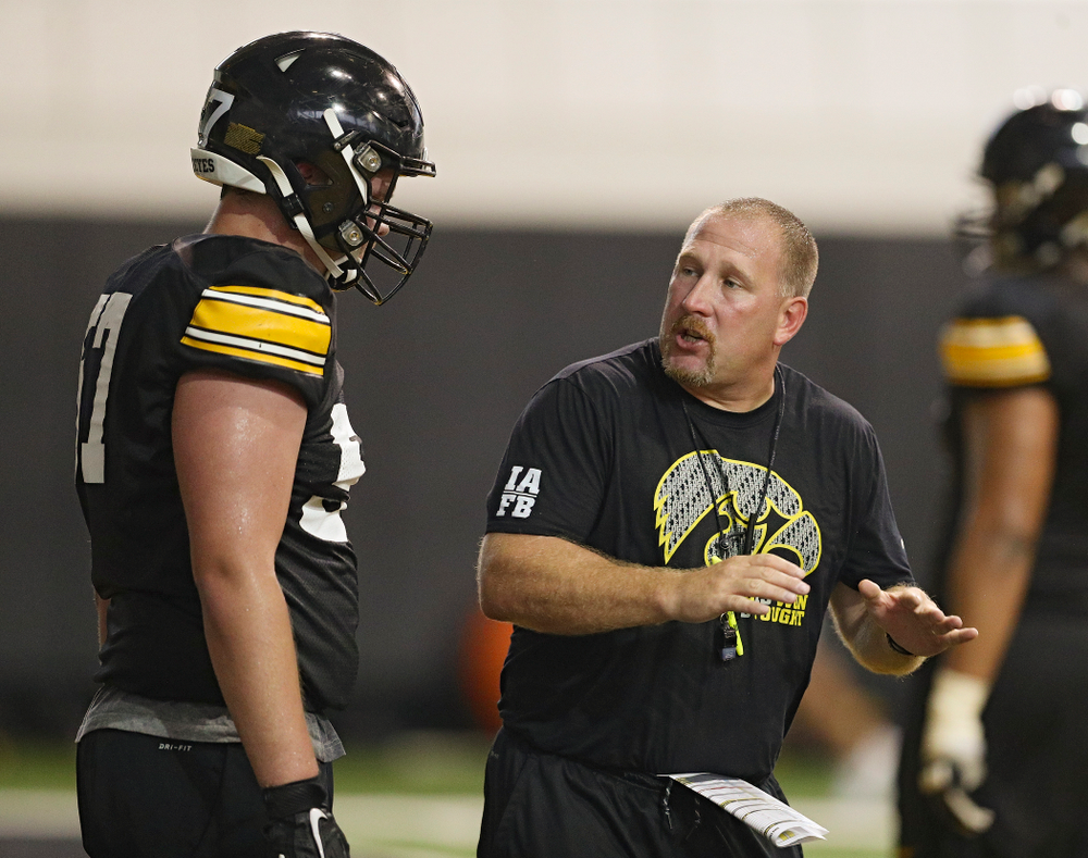 Iowa Hawkeyes offensive lineman Clayton Thurm (57) listens to offensive line coach Tim Polasek during Fall Camp Practice No. 9 at the Hansen Football Performance Center in Iowa City on Monday, Aug 12, 2019. (Stephen Mally/hawkeyesports.com)