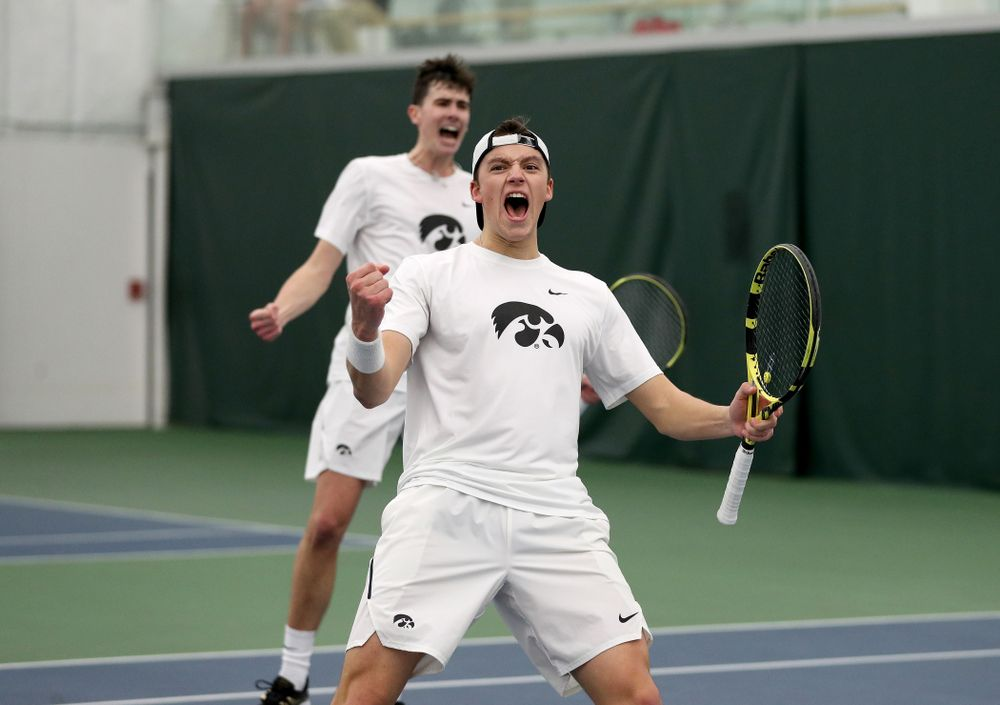Iowa's Joe Tyler and Matt Cleggle celebrating after winning  a doubles match against Cornell Sunday, March 8, 2020 at the Hawkeye Tennis and Recreation Center. (Brian Ray/hawkeyesports.com)