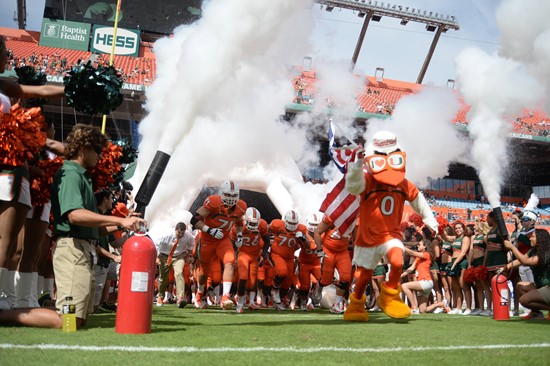 University of Miami Hurricanes head coach Al Golden leads his team on the field in a game against the Wake Forest Demon Deacons at Sun Life Stadium on...