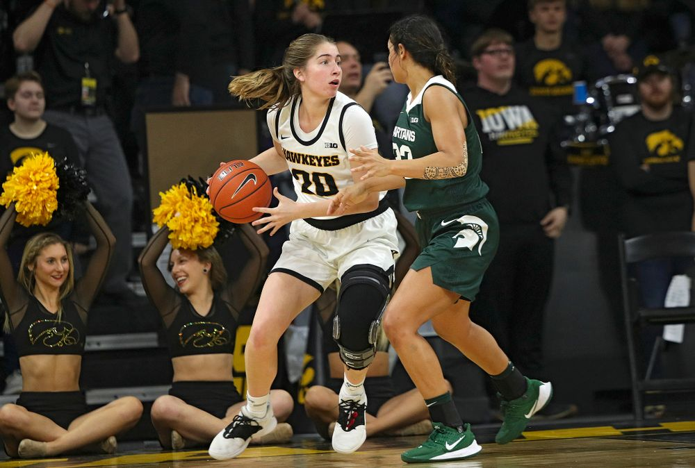 Iowa Hawkeyes guard Kate Martin (20) looks to pass during the fourth quarter of their game at Carver-Hawkeye Arena in Iowa City on Sunday, January 26, 2020. (Stephen Mally/hawkeyesports.com)