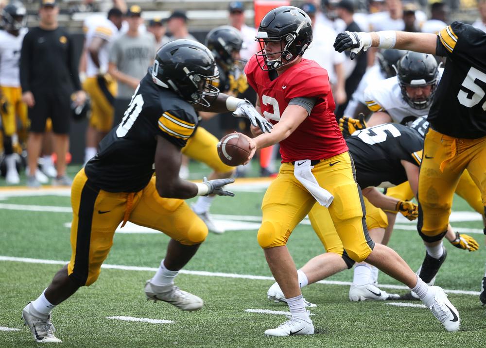 Iowa Hawkeyes running back Mekhi Sargent (10), Iowa Hawkeyes quarterback Peyton Mansell