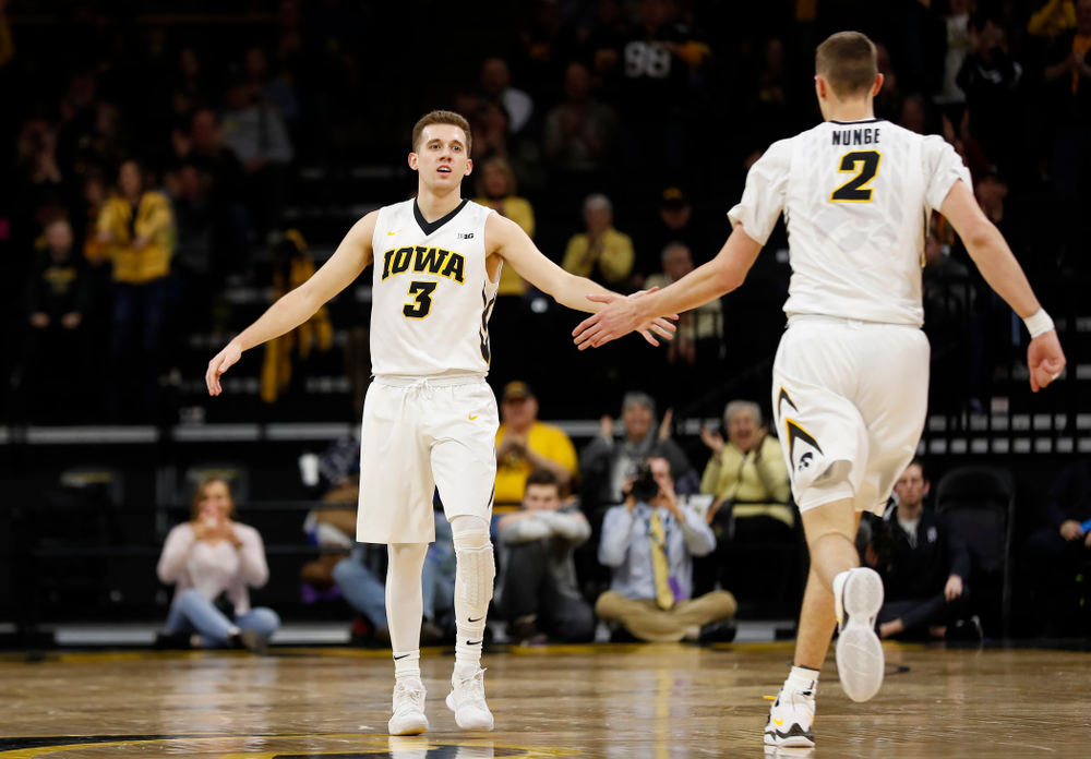 Iowa Hawkeyes guard Jordan Bohannon (3) and forward Jack Nunge (2)