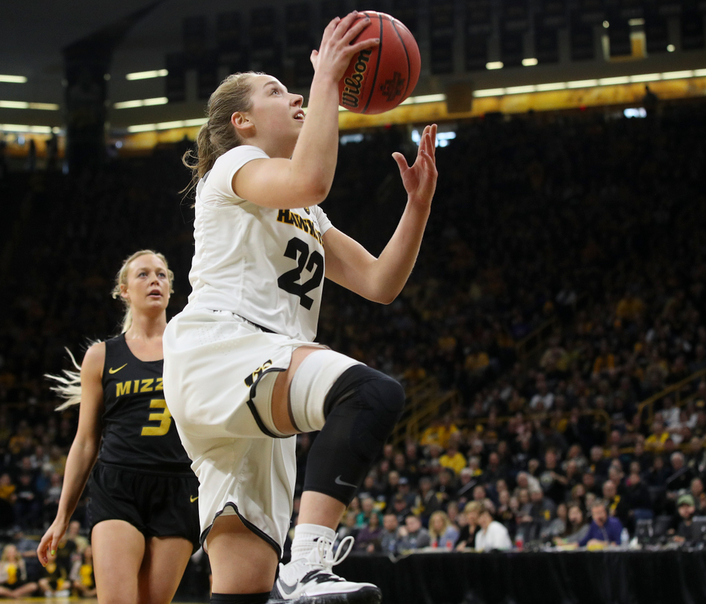 Iowa Hawkeyes guard Kathleen Doyle (22) scores a basket during the first quarter of their second round game in the 2019 NCAA Women's Basketball Tournament at Carver Hawkeye Arena in Iowa City on Sunday, Mar. 24, 2019. (Stephen Mally for hawkeyesports.com)