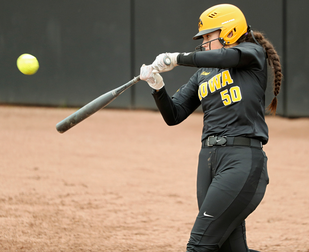 Iowa infielder Kalena Burns (50) hits a double during the fourth inning of their game against Iowa Softball vs Indian Hills Community College at Pearl Field in Iowa City on Sunday, Oct 6, 2019. (Stephen Mally/hawkeyesports.com)