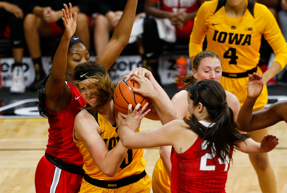 Iowa Hawkeyes forward Megan Gustafson (10) fights for a rebound during a game against the Ohio State Buckeyes at Carver-Hawkeye Arena on January 25, 2018. (Tork Mason/hawkeyesports.com)