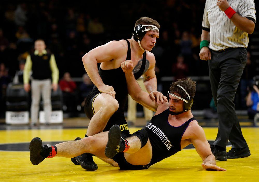 Iowa's Cash Wilcke wrestles Northwestern's Zack Chakonis at 197 pounds