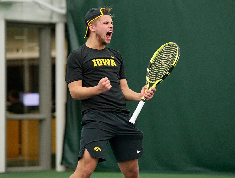 Iowa's Will Davies celebrates after winning his match at the Hawkeye Tennis and Recreation Complex in Iowa City on Thursday, January 16, 2020. (Stephen Mally/hawkeyesports.com)