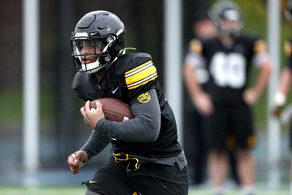 Iowa Hawkeyes running back Mekhi Sargent (10) carrels the ball during practice Monday, December 23, 2019 at Mesa College in San Diego. (Brian Ray/hawkeyesports.com)