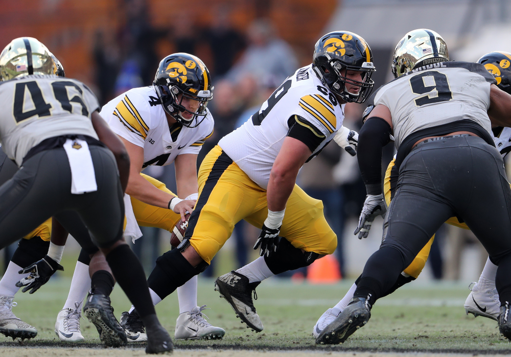 Iowa Hawkeyes offensive lineman Keegan Render (69) and quarterback Nate Stanley (4) against the Purdue Boilermakers Saturday, November 3, 2018 Ross Ade Stadium in West Lafayette, Ind. (Brian Ray/hawkeyesports.com)