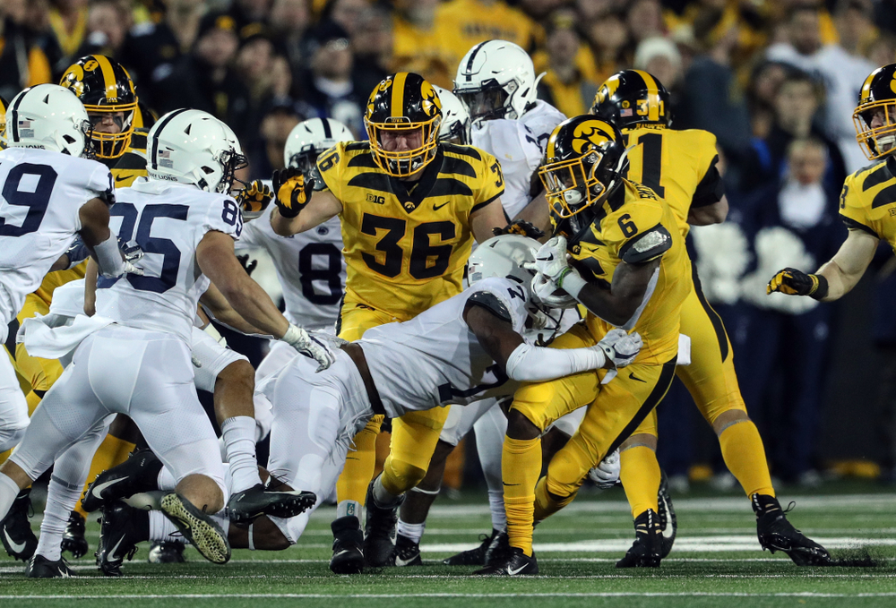 Iowa Hawkeyes fullback Brady Ross (36) blocks for wide receiver Ihmir Smith-Marsette (6) as he returns a kick against the Penn State Nittany Lions Saturday, October 12, 2019 at Kinnick Stadium. (Brian Ray/hawkeyesports.com)