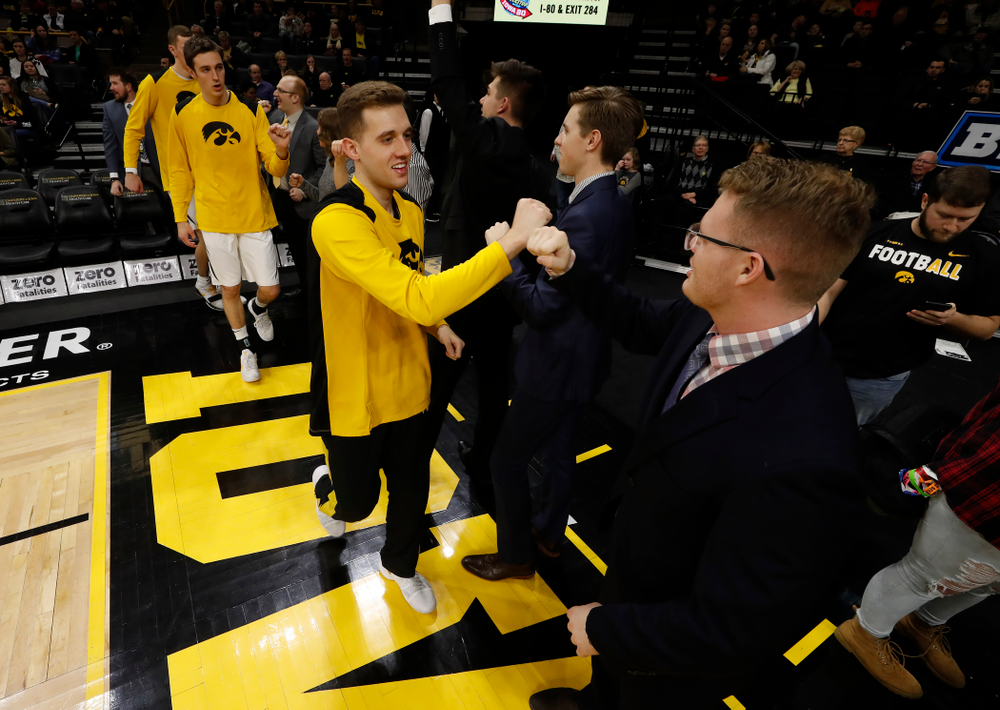 Iowa Hawkeyes guard Jordan Bohannon (3) and manager Lucas Pauley