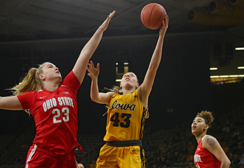 Iowa Hawkeyes forward Amanda Ollinger (43) makes a basket during the first quarter of their game at Carver-Hawkeye Arena in Iowa City on Thursday, January 23, 2020. (Stephen Mally/hawkeyesports.com)