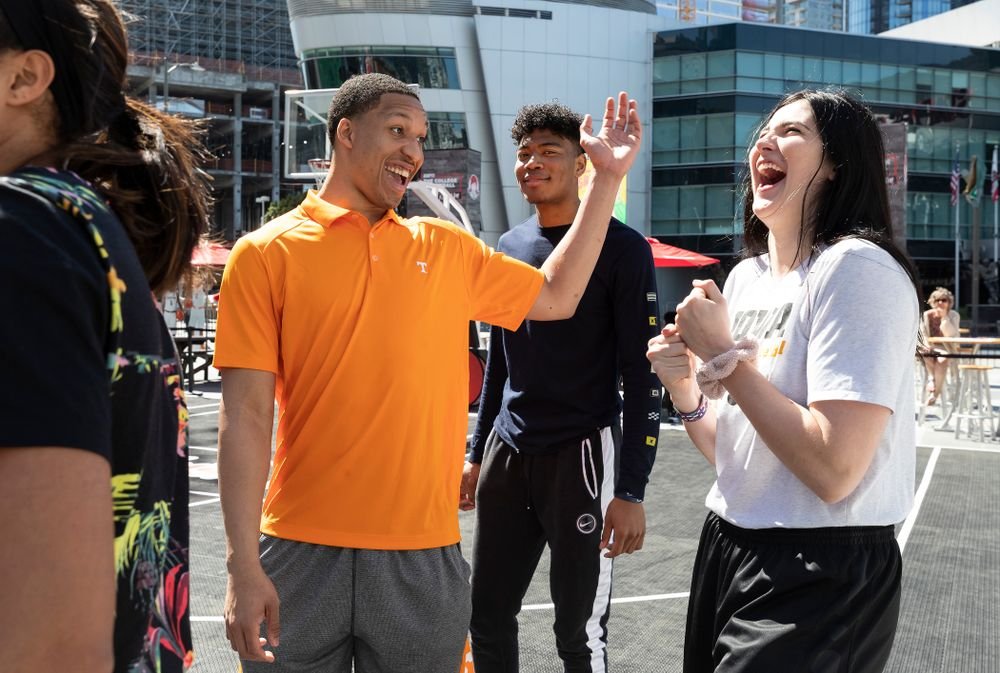 Iowa Hawkeyes forward Megan Gustafson (10) laughs with TennesseeÕs Grant Williams during a Special Olympics Event Friday, April 12, 2019 in the XBOX Plaza at LA Live.  (Brian Ray/hawkeyesports.com)