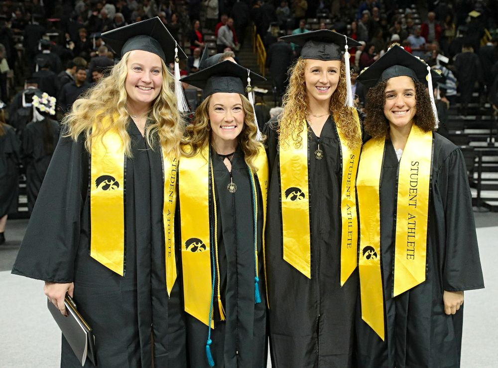 Iowa Track and Field's Allison Wahrman (from left), Lindsay Welker, Kylie Morken, and Tia Saunders after the College of Liberal Arts and Sciences and University College Fall 2019 Commencement ceremony at Carver-Hawkeye Arena in Iowa City on Saturday, December 21, 2019. (Stephen Mally/hawkeyesports.com)