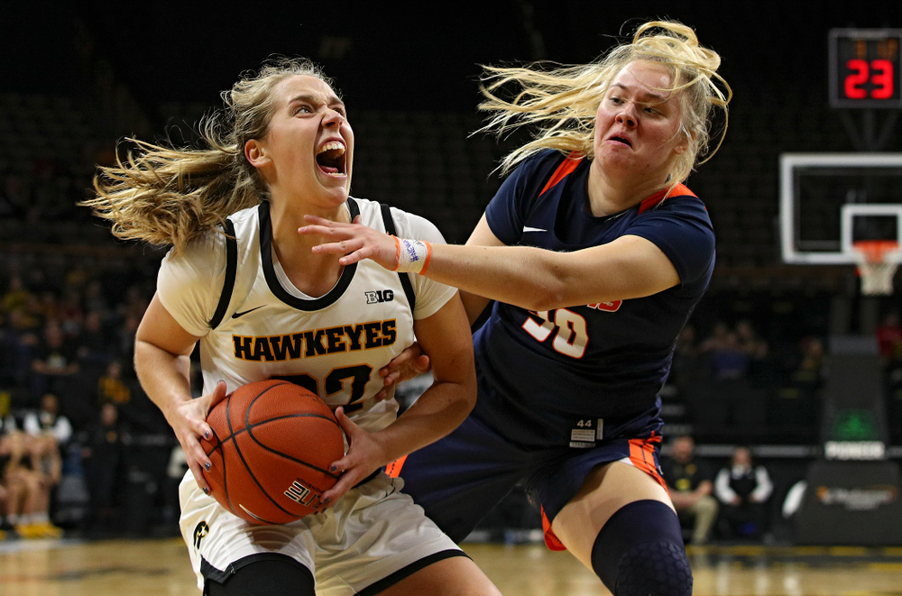 Iowa Hawkeyes guard Kathleen Doyle (22) drives to the basket during the second quarter of their game at Carver-Hawkeye Arena in Iowa City on Tuesday, December 31, 2019. (Stephen Mally/hawkeyesports.com)