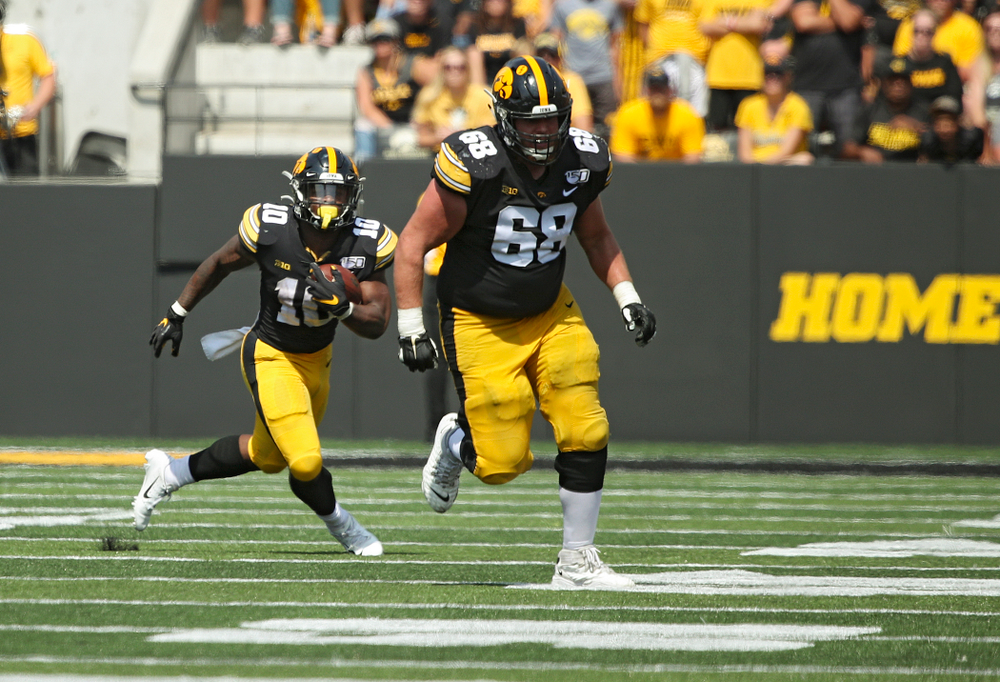 Iowa Hawkeyes running back Mekhi Sargent (10) runs after pulling in a pass as offensive lineman Landan Paulsen (68) looks to block during the third quarter of their Big Ten Conference football game at Kinnick Stadium in Iowa City on Saturday, Sep 7, 2019. (Stephen Mally/hawkeyesports.com)