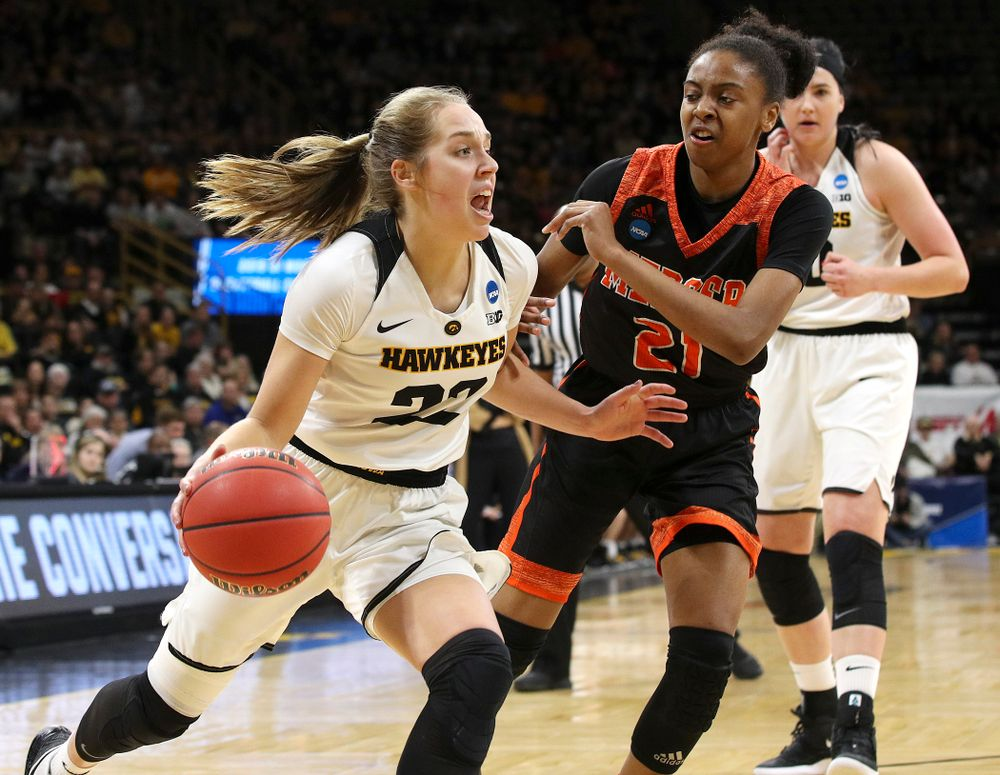 Iowa Hawkeyes guard Kathleen Doyle (22) drives around Mercer Bears guard Shannon Titus (21) during the first round of the 2019 NCAA Women's Basketball Tournament at Carver Hawkeye Arena in Iowa City on Friday, Mar. 22, 2019. (Stephen Mally for hawkeyesports.com)