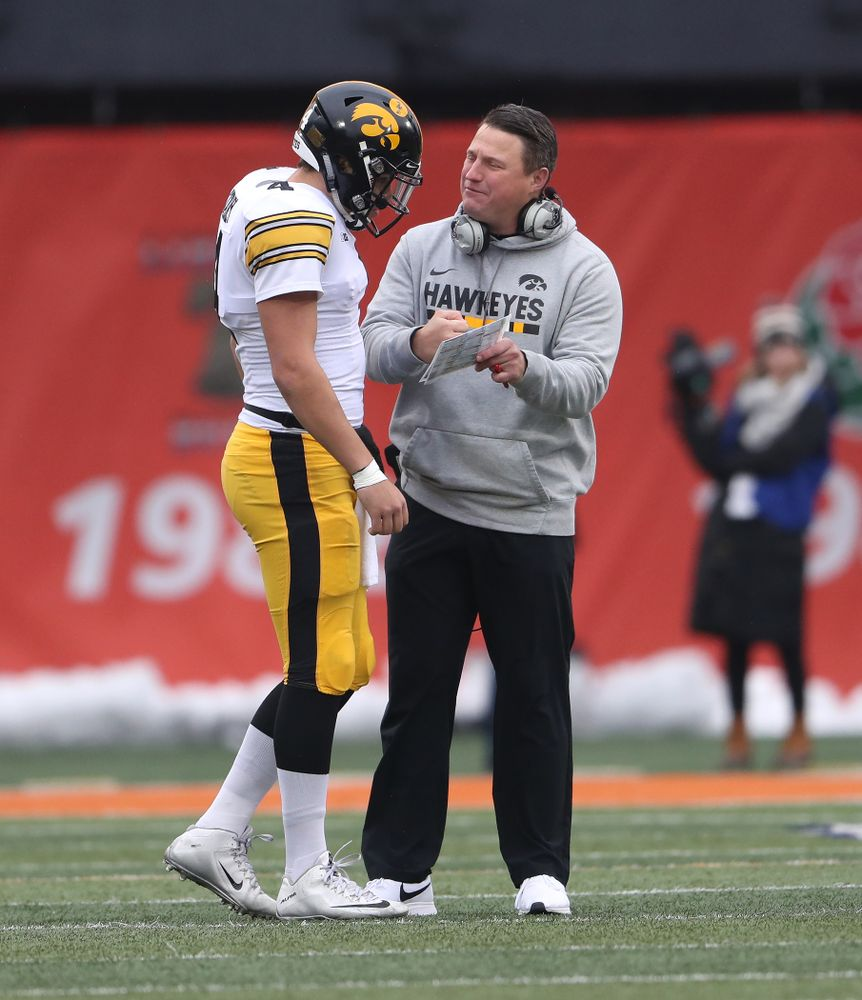 Iowa Hawkeyes offensive coordinator Brian Ferentz talks with quarterback Nate Stanley (4) against the Illinois Fighting Illini Saturday, November 17, 2018 at Memorial Stadium in Champaign, Ill. (Brian Ray/hawkeyesports.com)