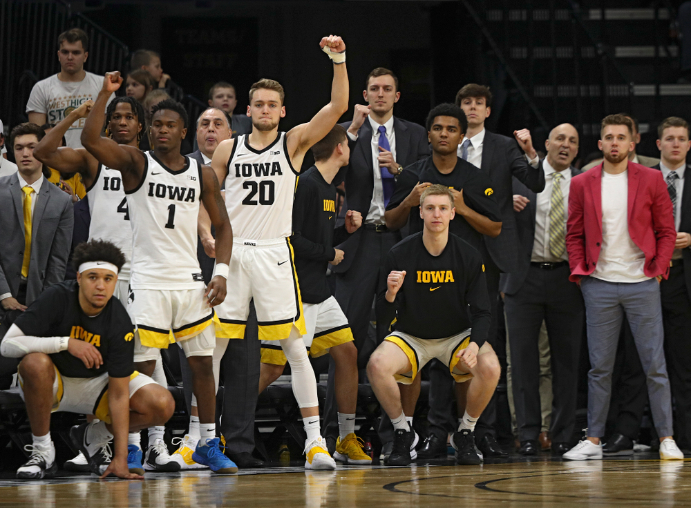 The Iowa bench celebrates after a stop during the second half of the game at Carver-Hawkeye Arena in Iowa City on Sunday, February 2, 2020. (Stephen Mally/hawkeyesports.com)