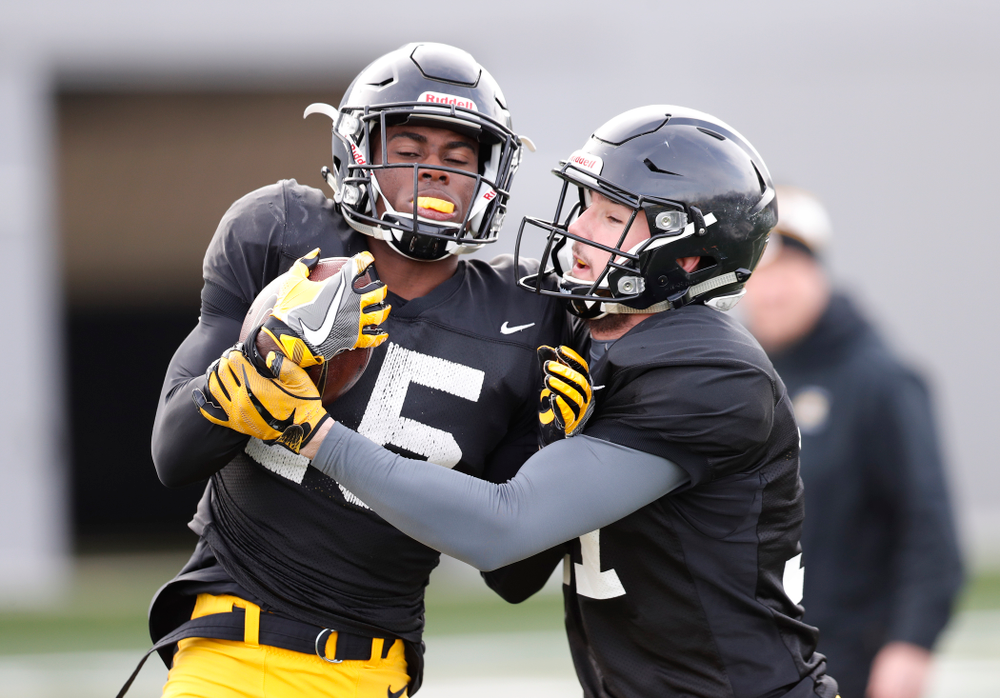 Iowa Hawkeyes defensive back Joshua Jackson (15) and