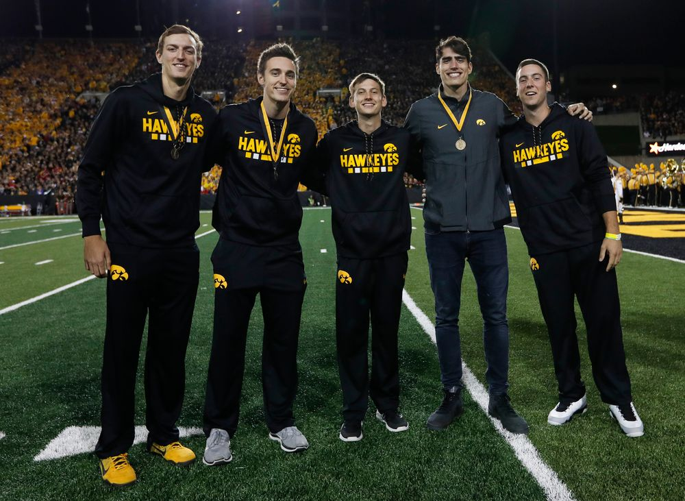 Members of the Iowa men's basketball team are recognized by the Presidential Committee on Athletics at halftime during a game against Wisconsin on September 22, 2018. (Tork Mason/hawkeyesports.com)