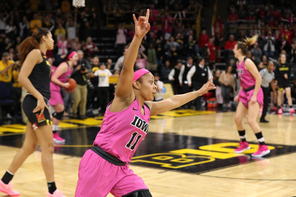 Iowa Hawkeyes guard Tania Davis (11) celebrates their victory against the seventh ranked Maryland Terrapins Sunday, February 17, 2019 at Carver-Hawkeye Arena. (Brian Ray/hawkeyesports.com)