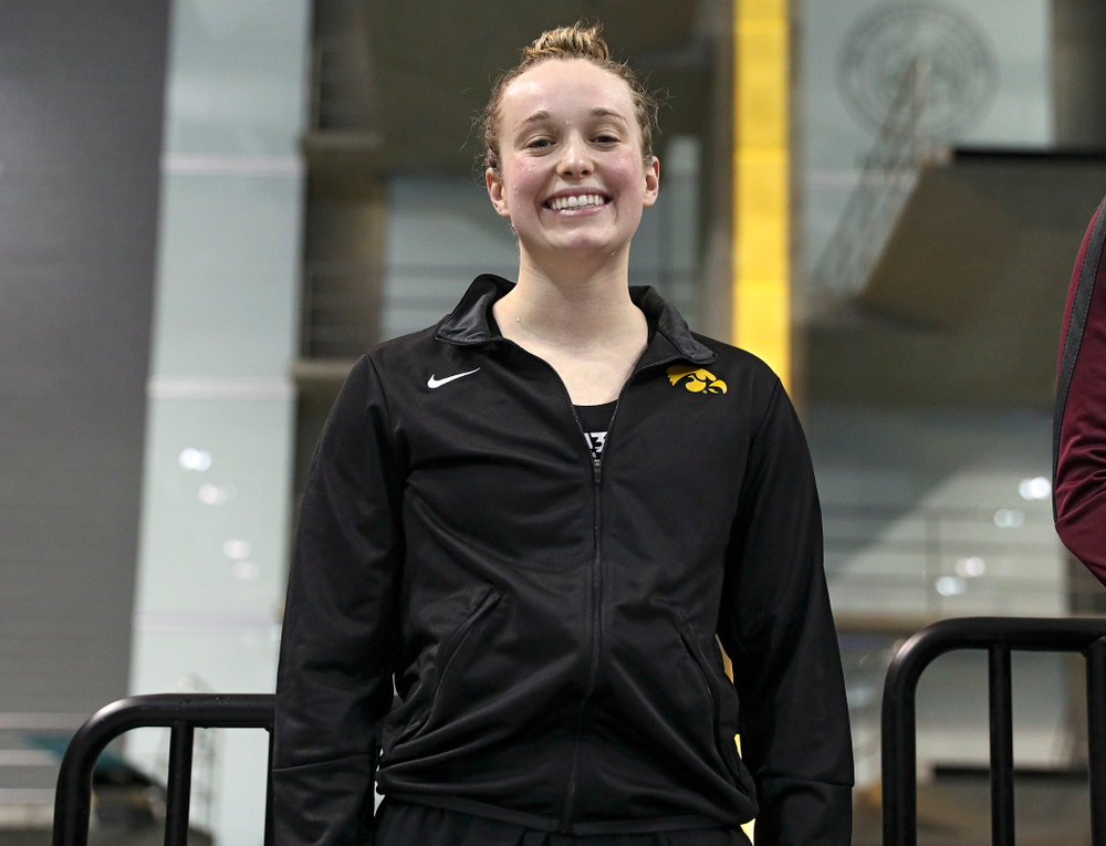 Iowa's Kelsey Drake on the awards stand after swimming the women's 100 yard butterfly final event during the 2020 Women's Big Ten Swimming and Diving Championships at the Campus Recreation and Wellness Center in Iowa City on Friday, February 21, 2020. (Stephen Mally/hawkeyesports.com)