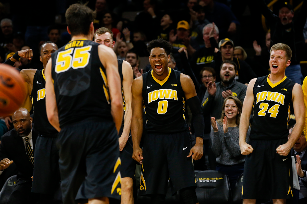 Iowa Hawkeyes forward Ahmad Wagner (0), Iowa Hawkeyes guard Brady Ellingson (24)