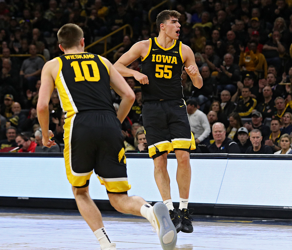 Iowa Hawkeyes center Luka Garza (55) celebrates after making a 3-pointer during the second half of their game at Carver-Hawkeye Arena in Iowa City on Monday, January 27, 2020. (Stephen Mally/hawkeyesports.com)