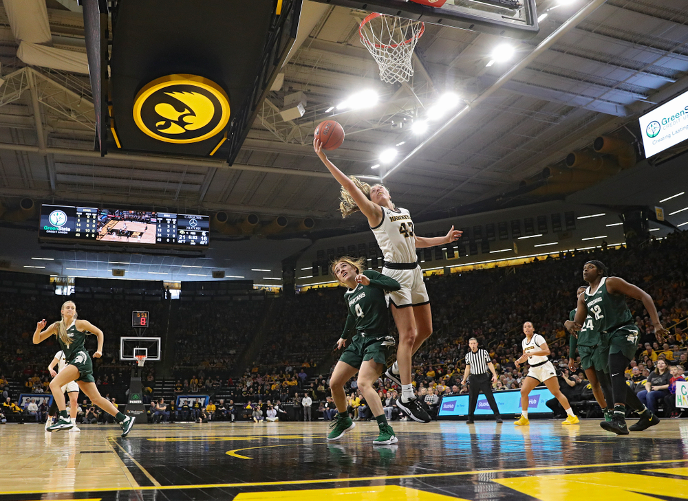 Iowa Hawkeyes forward Amanda Ollinger (43) pulls in a rebound during the second quarter of their game at Carver-Hawkeye Arena in Iowa City on Sunday, January 26, 2020. (Stephen Mally/hawkeyesports.com)