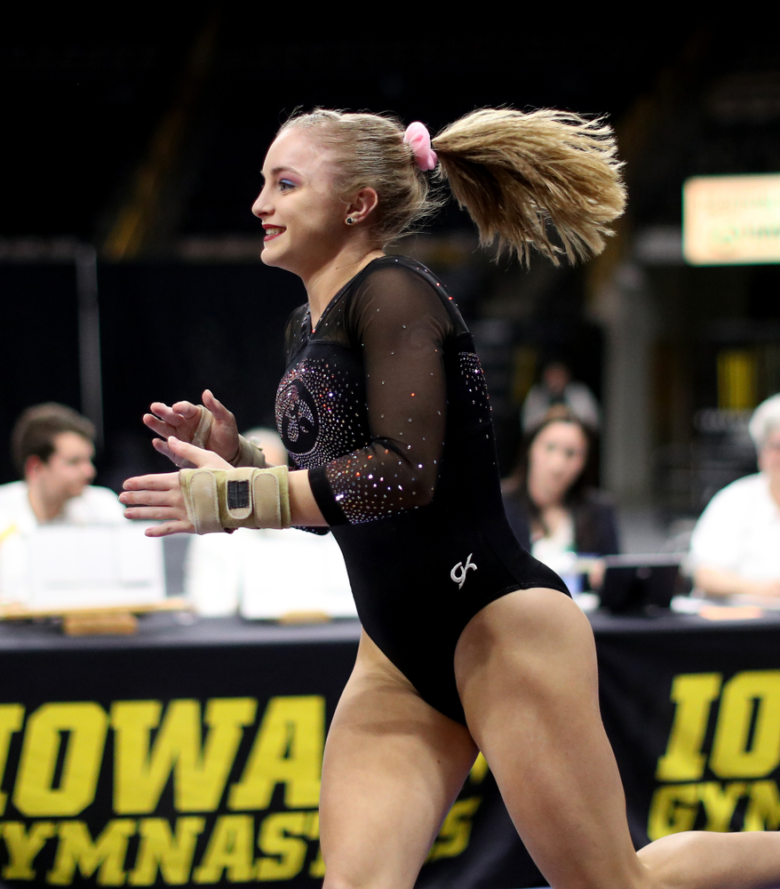 Iowa's Lauren Guerin competes on the vault against Michigan Friday, February 14, 2020 at Carver-Hawkeye Arena. (Brian Ray/hawkeyesports.com)
