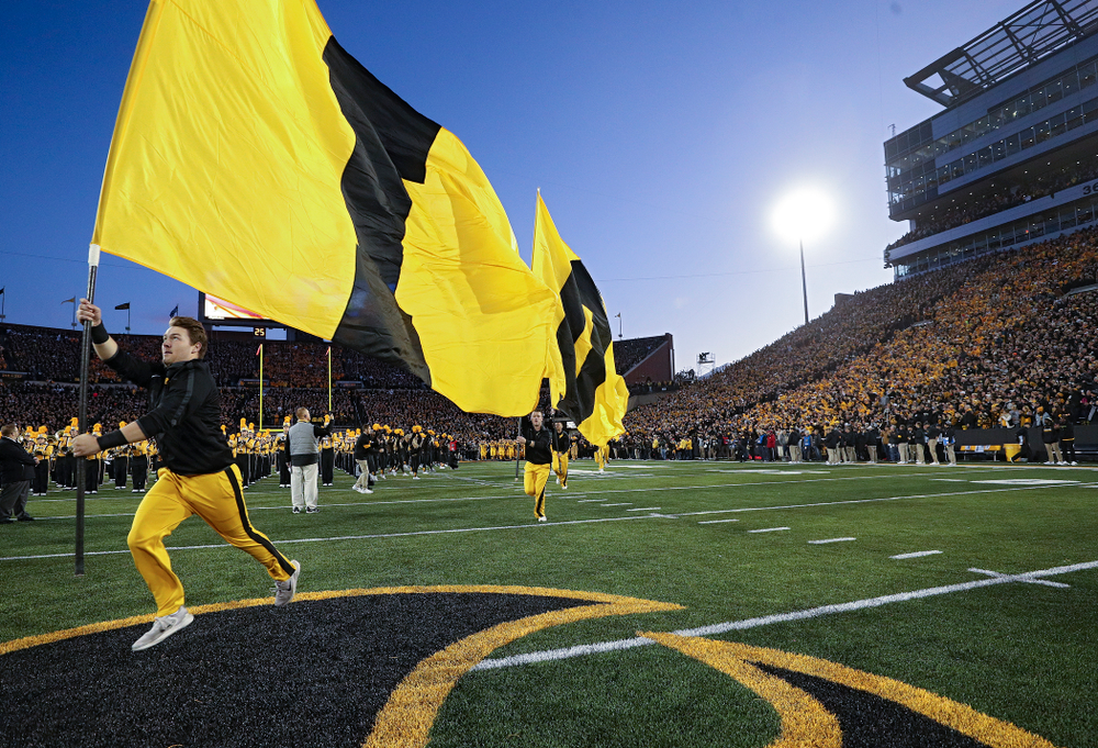 The Hawkeyes swarm as they take the field before their game at Kinnick Stadium in Iowa City on Saturday, Oct 12, 2019. (Stephen Mally/hawkeyesports.com)