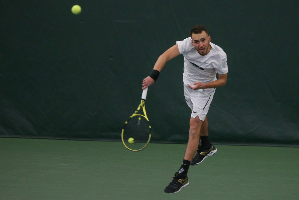 Iowa's Kareem Allaf serves the ball during the Iowa men's tennis meet vs Nebraska on Sunday, March 1, 2020 at the Hawkeye Tennis and Recreation Complex. (Lily Smith/hawkeyesports.com)