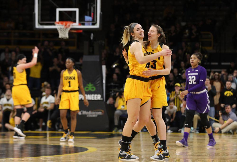 Iowa Hawkeyes forward Hannah Stewart (21) and forward Amanda Ollinger (43) against the Northwestern Wildcats Sunday, March 3, 2019 at Carver-Hawkeye Arena. (Brian Ray/hawkeyesports.com)