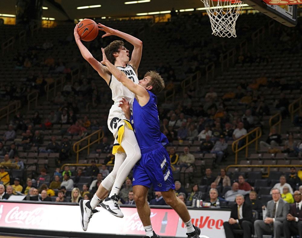 Iowa Hawkeyes forward Patrick McCaffery (22) puts up a shot during the second half of their exhibition game against Lindsey Wilson College at Carver-Hawkeye Arena in Iowa City on Monday, Nov 4, 2019. (Stephen Mally/hawkeyesports.com)