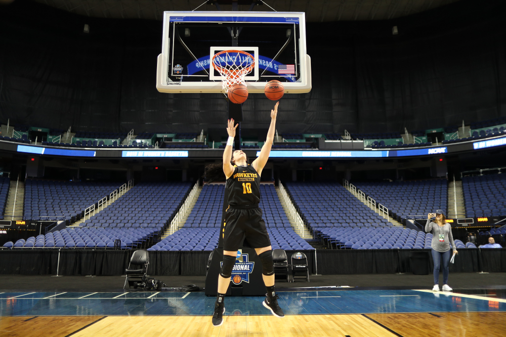 Iowa Hawkeyes forward Megan Gustafson (10) does the reverse Mikan Drill the ESPN Crew following practice for their Sweet 16 matchup against NC State Friday, March 29, 2019 at the Greensboro Coliseum in Greensboro, NC.(Brian Ray/hawkeyesports.com)