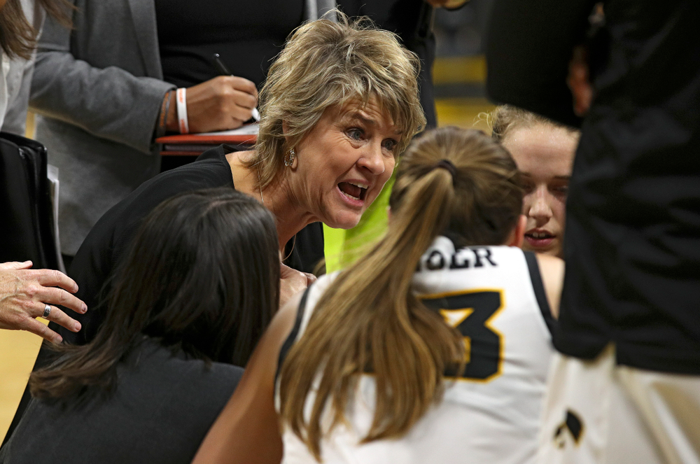 Iowa head coach Lisa Bluder talks with her team during a timeout in the fourth quarter of their overtime win against Princeton at Carver-Hawkeye Arena in Iowa City on Wednesday, Nov 20, 2019. (Stephen Mally/hawkeyesports.com)