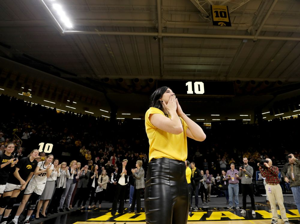 Megan Gustafson blows a kiss to the fans after her number was raised into the rafters during a jersey retirement ceremony Sunday, January 26, 2020 at Carver-Hawkeye Arena. (Brian Ray/hawkeyesports.com)