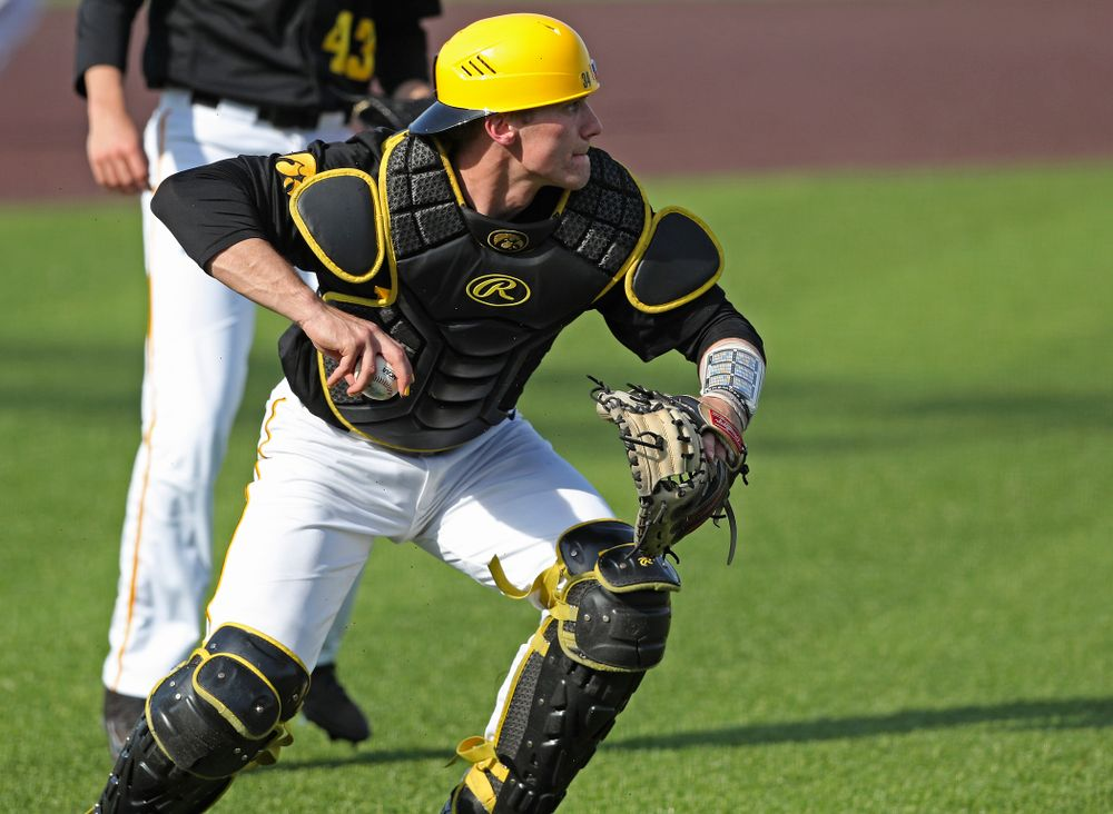 Iowa Hawkeyes catcher Austin Martin (34) throws to first for an out during the seventh inning of their game against Rutgers at Duane Banks Field in Iowa City on Saturday, Apr. 6, 2019. (Stephen Mally/hawkeyesports.com)