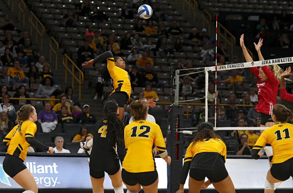 Iowa's Griere Hughes (10) gets up for a kill during their match at Carver-Hawkeye Arena in Iowa City on Sunday, Oct 20, 2019. (Stephen Mally/hawkeyesports.com)