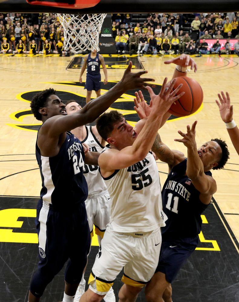 Iowa Hawkeyes forward Luka Garza (55) battles for a rebound against Penn State Saturday, February 29, 2020 at Carver-Hawkeye Arena. (Brian Ray/hawkeyesports.com)