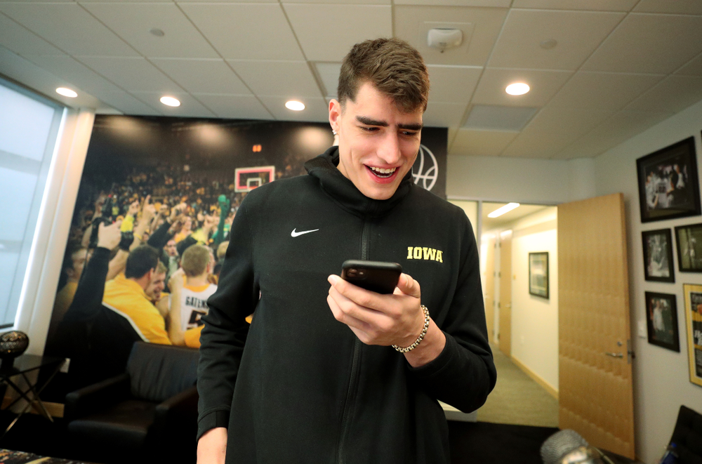 Iowa Hawkeyes forward Luka Garza (55) calls his dad after finding out that he has been named the Big Ten Player of the Year Monday, March 9, 2020 at Carver-Hawkeye Arena. (Brian Ray/hawkeyesports.com)