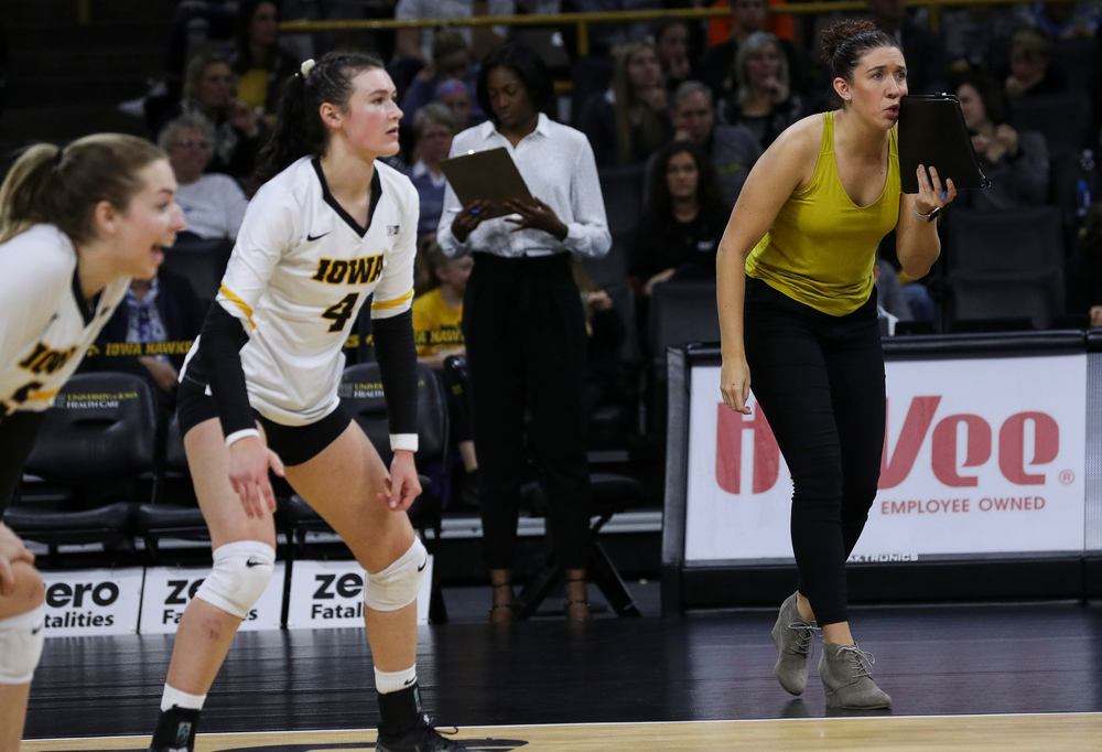 Iowa Hawkeyes assistant coach Bre Payton gives instructions between points during a match against Penn State at Carver-Hawkeye Arena on November 3, 2018. (Tork Mason/hawkeyesports.com)