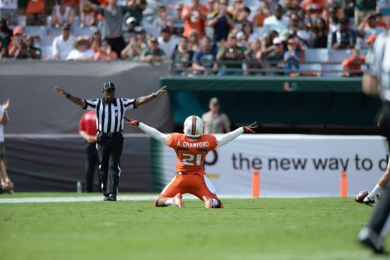 University of Miami Hurricanes defensive back Antonio Crawford #21 deflects a ball away in a game against the Wake Forest Demon Deacons at Sun Life...