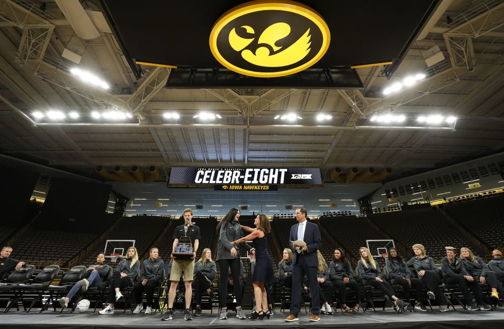 Iowa Hawkeyes forward Megan Gustafson (10) is presented with the Naismith Player Of The Year Trophy during the teamÕs Celebr-Eight event Wednesday, April 24, 2019 at Carver-Hawkeye Arena. (Brian Ray/hawkeyesports.com)