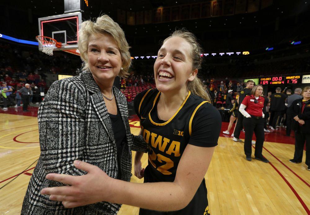 Iowa Hawkeyes guard Kathleen Doyle (22) and head coach Lisa Bluder against the Iowa State Cyclones Wednesday, December 11, 2019 at Hilton Coliseum in Ames, Iowa(Brian Ray/hawkeyesports.com)