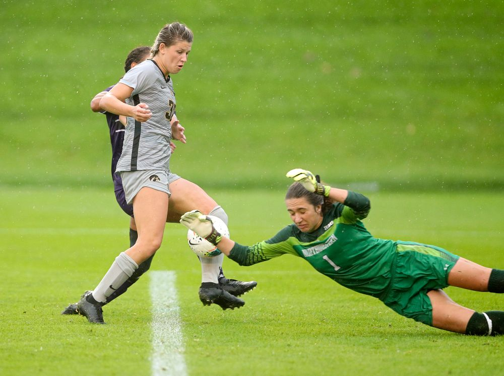 Iowa forward Gianna Gourley (32) tries to sneak a shot by Northwestern goalkeeper Mackenzie Wood (1) during overtime of their match at the Iowa Soccer Complex in Iowa City on Sunday, Sep 29, 2019. (Stephen Mally/hawkeyesports.com)